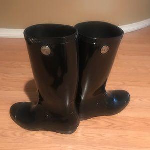 Shaye Ugg black rain boots.